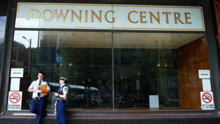 Police officers talk in front of the Downing Centre local courts on February 19, 2015 in Sydney, Australia.