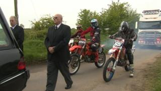 Motocross bikes escorting Billy Hines' coffin
