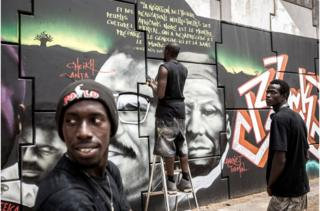 Members of Radikal Bomb Shot (RBS) collective, a collective of Senegalese artists, paint a mural of key American and African anti-racism activists in a show of support for the Black Lives Matter movement in Dakar on June, 15, 2020.