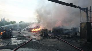 Fire crews tackle blaze at Kirkby oil processing plant.