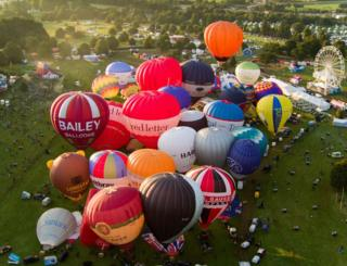 Lots of hot air balloons gather together at the Bristol International Balloon Fiesta