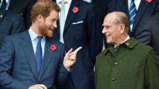 Princes Philip and Harry laughing