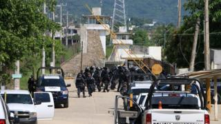 Riot police enter a prison after a riot broke out at the maximum security wing in Acapulco, Mexico