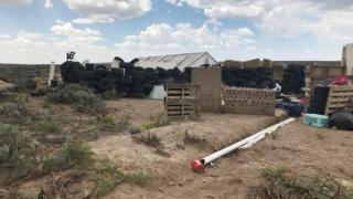 A view of the compound in rural New Mexico where 11 children were taken in protective custody after a raid by authorities near Amalia, New Mexico, on 10 August 2018.