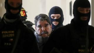 Syrian Kurdish leader Saleh Muslim (C) is escorted by Czech police for his trial at the municipal court on February 27, 2018 in Prague.