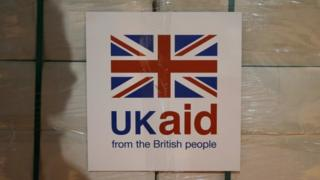 UK Aid sign on a box of supplies