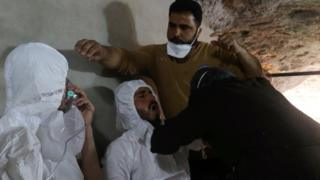 Men receive treatment after a gas attack in the Syrian town of Khan Sheikhoun