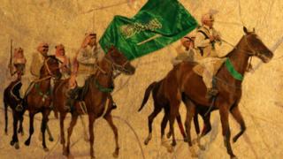صورة لفرسان يحملون علم السعودية
