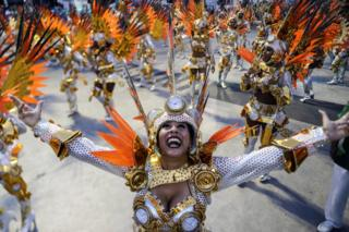 Members of the samba school of the Grupo Especial Especial Mocidade Independente de Padre Miguel take part in the traditional carnival parade at Marques de Sapucai sambadrome in Rio de Janeiro, Brazil, early 05 March 2019