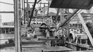 Man and child on Ferris wheel