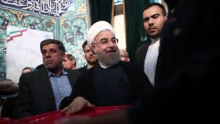 Iranian President and presidential candidate, Hassan Rouhani, casts his ballot for the presidential elections at a polling station in Tehran on May 19, 2017