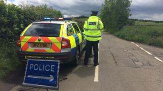Police car blocking the Belfast Road