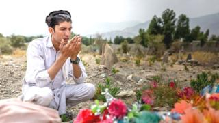 Nematullah at the unnamed soldier's grave