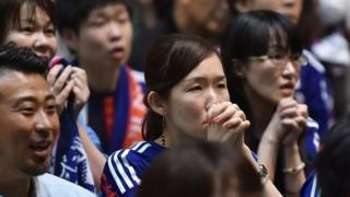 Japanese football supporters react as they attend a public screening in Tokyo on July 6, 2015, of the 2015 FIFA Women's World Cup final between Japan and USA being played in Vancouver, British Columbia.