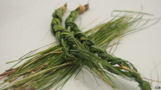 pieces of braided and unbraided sweetgrass