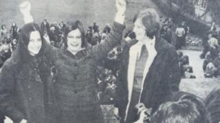 Roz (centre) celebrates being PM whilst 'Terri' May smiles on (picture right)