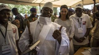 Gambian President Yahya Jammeh gesturing at a polling station