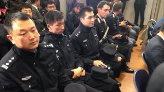 Chinese Police officers, seated at a news conference alongside Italian police and journalists, at the Italian Interior Ministry headquarters in Rome, 2 May 2016