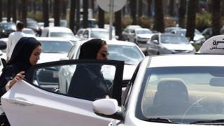 Saudi women get into a taxi at a street in the Saudi capital Riyadh. Photo: 28 September 2017