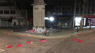 Wreaths strewn around the war memorial in Regent Street, Swindon