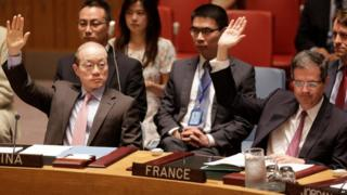 China and France's permanent representatives to the UN vote in favour of a resolution endorsing the Iranian nuclear deal (20 July 2015)