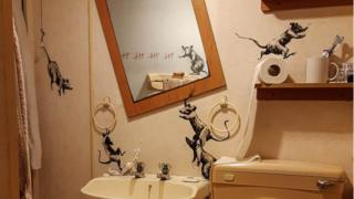 Banksy's bathroom decorated with rat art