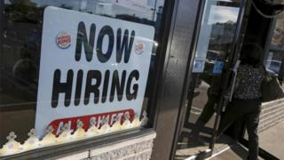 "Sign saying ""now hiring"""