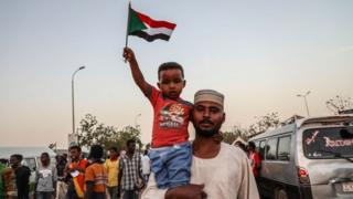 Sudanese demonstrators gather in front of military headquarters during a demonstration after The Sudanese Professionals Association's (SPA) call, demanding a civilian transition government, in Khartoum, Sudan on 22 April 2019.
