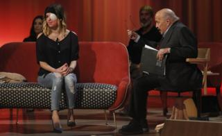 Gessica Notaro, appearing with Maurizio Costanzo (R)