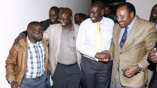 A handout picture taken and released on 5 April 2016 by the Deputy President's Office shows Kenya's Deputy President William Ruto (2nd R) celebrating in Nairobi with Joshua arup Sang (L) shortly after charges of crimes against humanity against them were dropped by the ICC