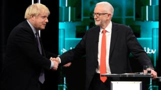 Conservative leader Boris Johnson and Labour leader Jeremy Corbyn shake hands during a televised debate ahead of general election in London, Britain, November 19, 2019
