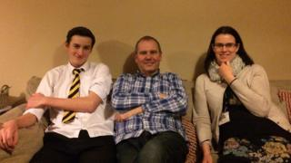 Pupil Callum Hall, mother Kath and Grandad John Healy on the sofa