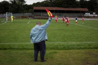 One of the backroom staff acting as a lineman at Millburn Park