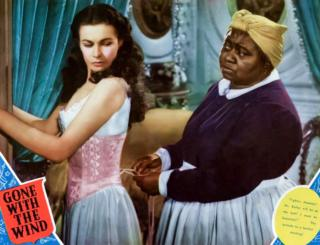 Gone with the Wind movie still showing Scarlett O'Hara (Vivien Leigh) and her archetypal Negro housemaid Mammy (Hattie McDaniel)