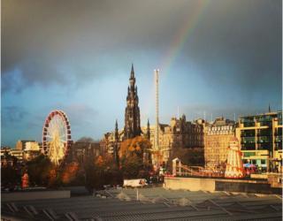 Rainbow above Scott Monument and Edinburgh Christmas markets