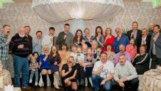 Darya Lazareva and her family pose holding up fake moustaches
