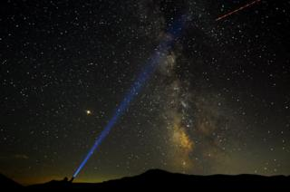 A man points his light at the Milky Way during the peak of the Perseid meteor shower at Mavrovo national park in Macedonia, 12 August 2018.