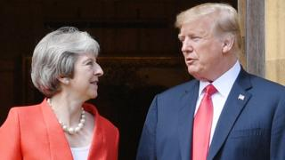 US President Donald Trump stands with Prime Minister Theresa May on the doorstep at Chequers