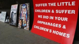 A protest poster at the Royal Commission into Child Abuse, Australia