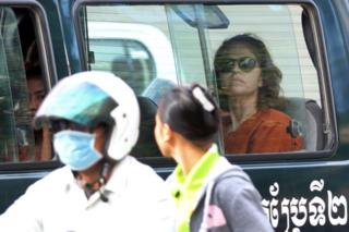 Australian national Tammy Davis-Charles (R), 49, sits in a prison car as she travels to Phnom Penh municipal court on 13 June 2017
