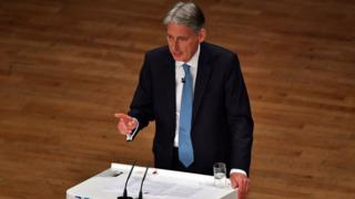 Chancellor of the Exchequer, Philip Hammond, delivers a speech about the economy on the second day of the Conservative Party Conference 2016 at the ICC Birmingham on October 3, 2016 in Birmingham, England.