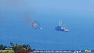 Photo posted online by militants purportedly showing a missile moments before hitting the ship