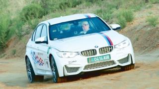 Gurbanguly Berdimuhamedov in his BMW sports car