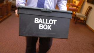 Man carrying ballot box