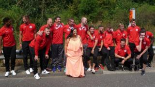 """Mystery bride"" with Needham Market FC players"