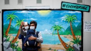 couple take selfie in Paris