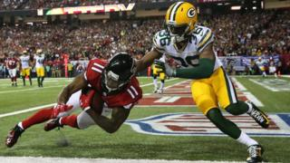 Atlanta Falcons wide receiver Julio Jones (11) scores a touchdown ahead of Green Bay Packers cornerback LaDarius Gunter (36) during the second quarter in the 2017 NFC Championship Game at the Georgia Dome.