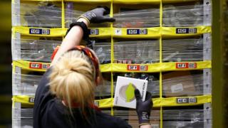 An employee works to stow items in robot-carried shelving systems at the Amazon fulfillment center in Kent, Washington, U.S., October 24, 2018.