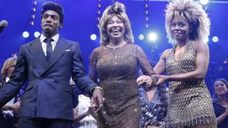 Daniel J Watts, Tina Turner and Adrienne Warren at curtain call for Tina: The Tina Turner Musical