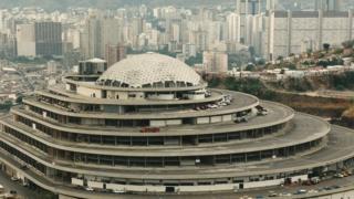 El Helicoide towering over sprawling slums in Caracas